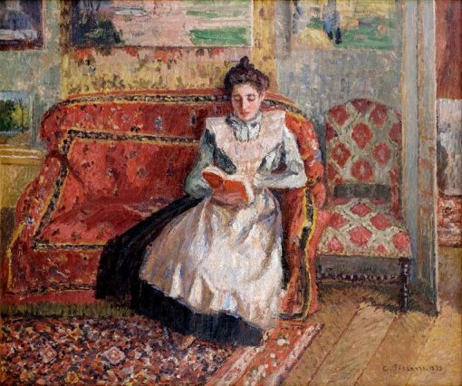 Camille_Pissarro,_Jeanne_Pissarro,_Called_Cocotte,_Reading,_1899._Oil_on_canvas