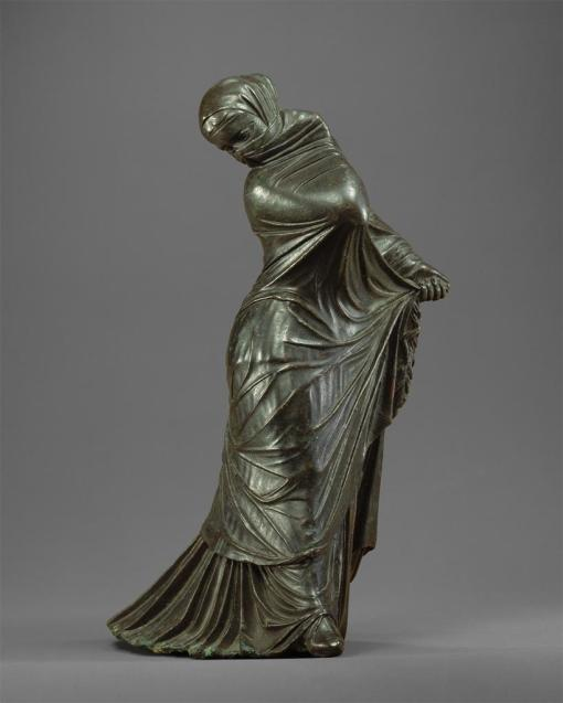 Bronze statuette of a veiled and masked dancer
